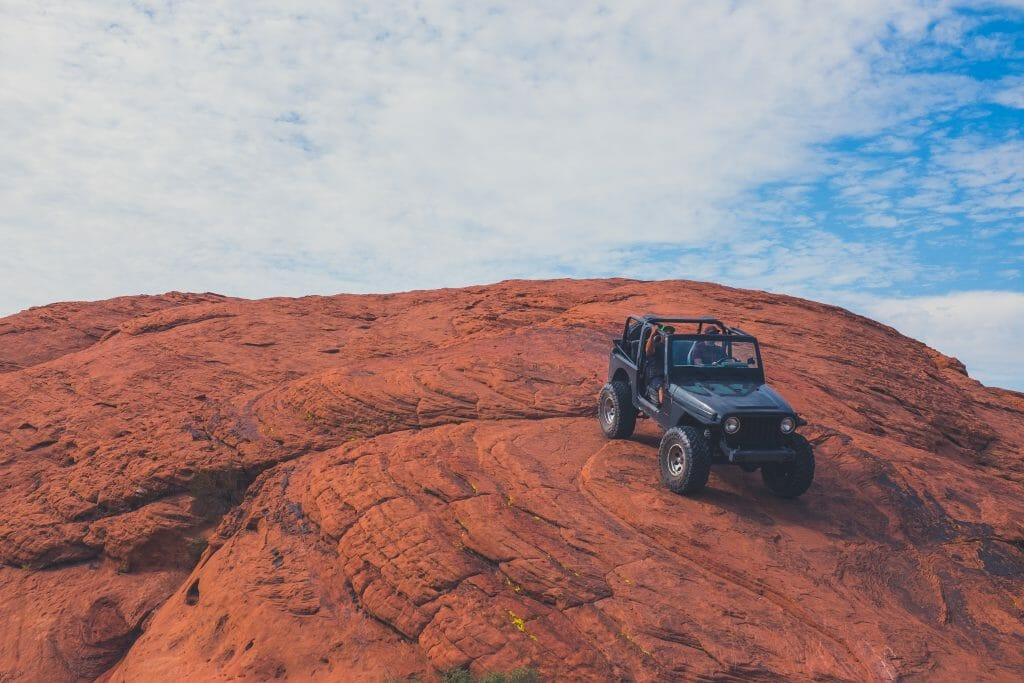 Jeep driving over rocks