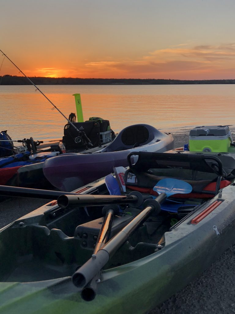 Kayak paddle sunset
